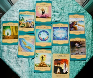 Some of Denise Linn's Gateway oracle Cards and a card from Doreen Virtue's Goddess cards.